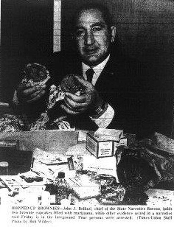 John J. Bellizzi, chief of the State Narcotics Bureau, shows off the brownies used to hide marijuana in a cache seized in Albany in May 1967. (Times Union archive)