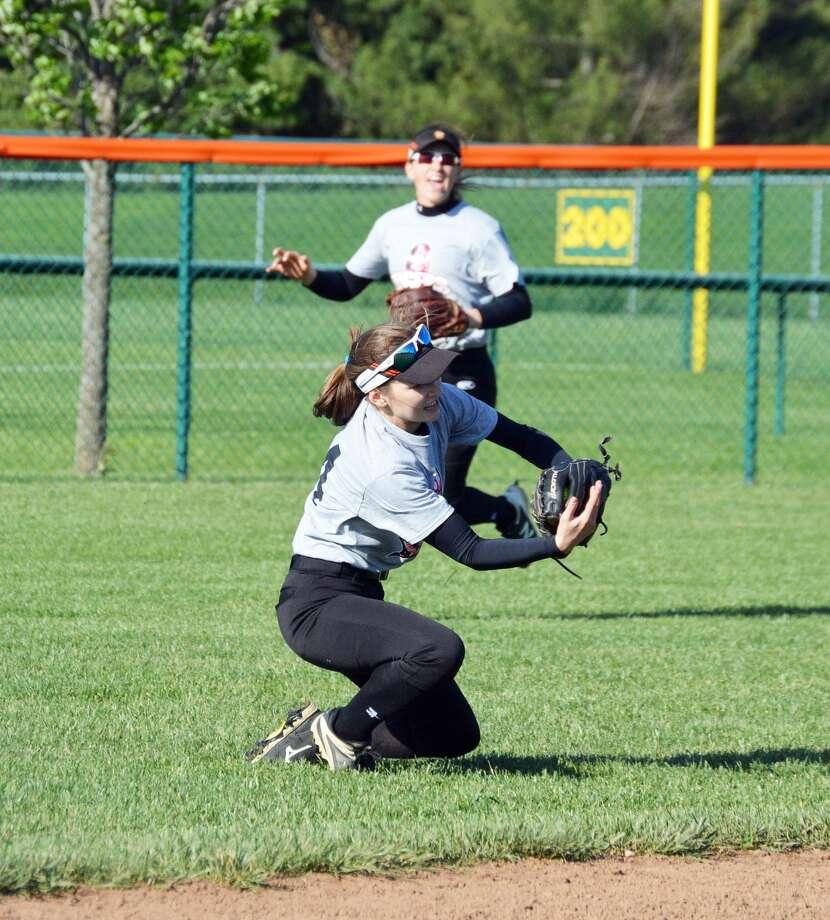 Edwardsville left fielder Lauren Taplin makes a sliding catch against Teutopolis during Friday's home game inside the District 7 Sports Complex.