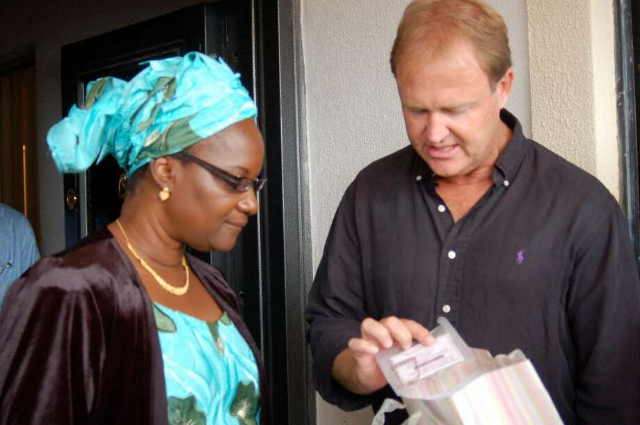 Greenwich native Peter Fretheim, shown in this undated photo speaking with a Nigerian woman, and his family have, for the past 11 years, lived in Jos, Nigeria, where he oversees seven care centers that assist orphans and the needy. Photo: Contributed Photo / Greenwich Time Contributed