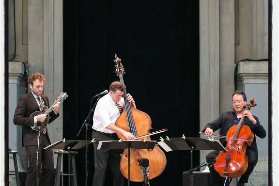 Musicians Christ Thile (at left) with Edgar Meyer and cellist Yo-Yo Ma performed an all-Bach program at the Greek Theater. April 30, 2017.