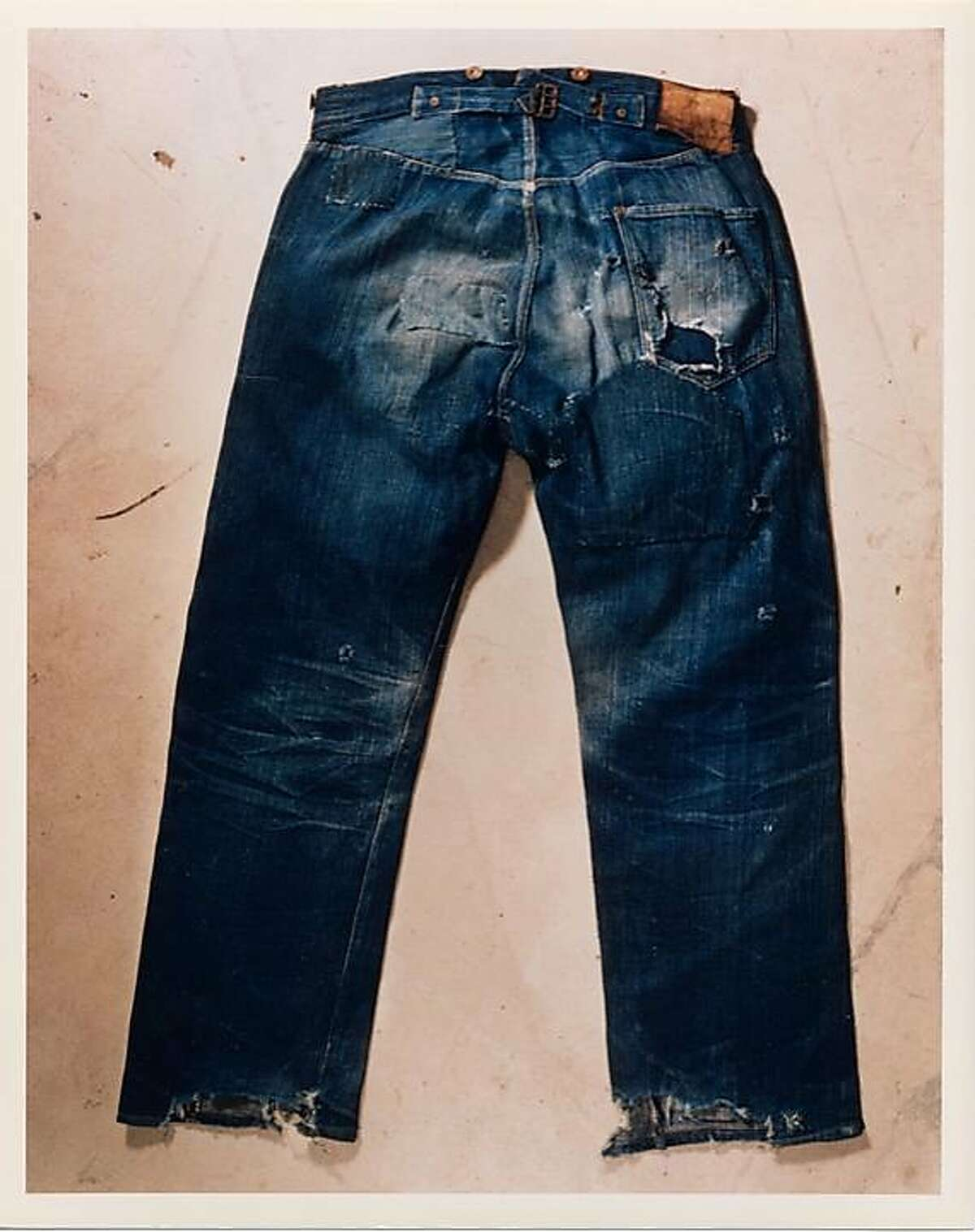 """9bcbf3bb88541 1890s  A pair of cowboy 501s from the 1800s preserved in the Levi s San  Francisco headquarters  archives. The authentic """"spur bites"""" at the hemline  indicate ..."""