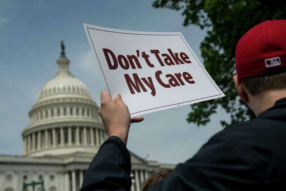 Demonstrators in Washington air their opposition to a Republican health care bill in May. Republicans have been trying for months to replace Obamacare. Photo: GABRIELLA DEMCZUK, STR / NYTNS