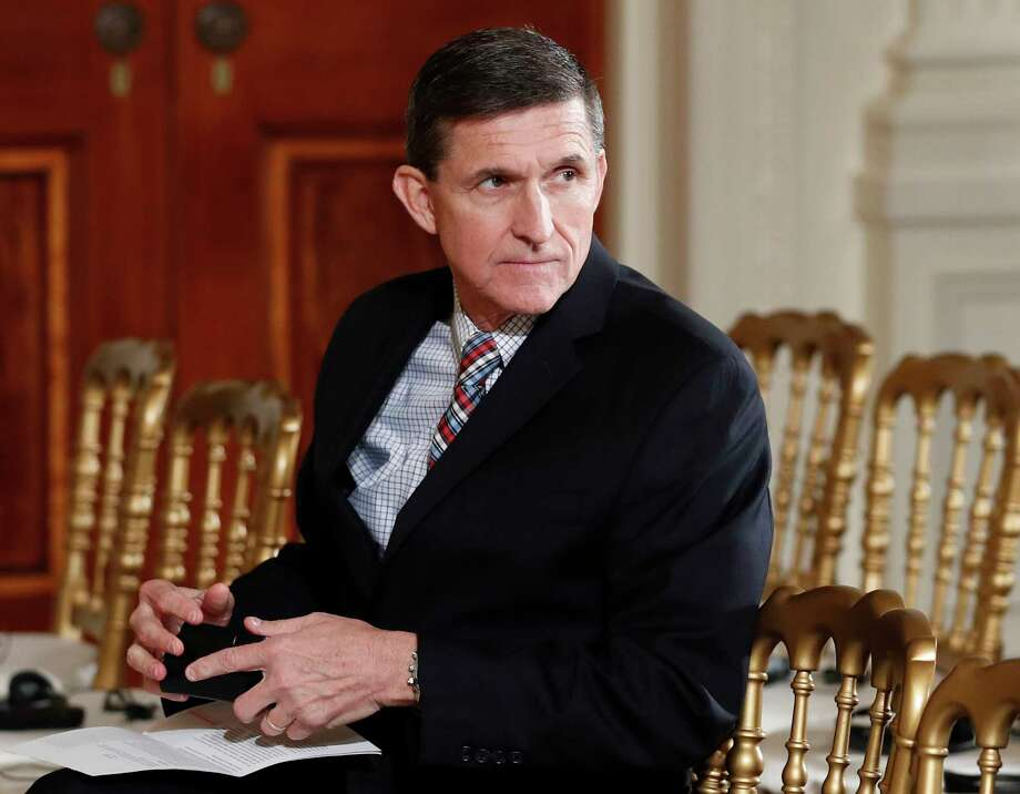 FILE - In this Feb. 10, 2017 file photo, then-National Security Adviser Michael Flynn sits in the East Room of the White House in Washington.  A member of Donald Trump's transition team asked national security officials in the Obama White House for the classified CIA profile on Russia's ambassador to the United States. The unusual request appears to signal that Trump's own team had concerns about whether his pick for national security adviser, Mike Flynn, fully understood that he was dealing with a man rumored to have ties to Russian intelligence agencies. (AP Photo/Carolyn Kaster, File) ORG XMIT: WX122 Photo: Carolyn Kaster / Copyright 2017 The Associated Press. All rights reserved.