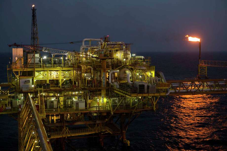 """Gas flares at a burner tower on a Pemex complex. """"The potential is huge in the oil and gas sector in Mexico,"""" says the Pemex CEO.  offshore from Ciudad del Carmen, Mexico Photo: Susana Gonzalez / © 2014 Bloomberg Finance LP"""