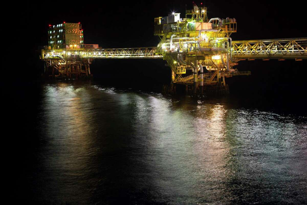 Lights illuminate a section of Petroleos Mexicanos (Pemex) Pol-A Platform complex, located on the continental shelf in the Gulf of Mexico, 70 kilometers offshore from Ciudad del Carmen, Mexico, on Friday, March 28, 2014.