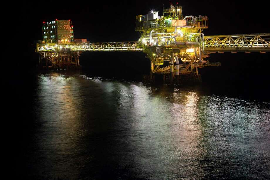 """Lights illuminate a section of Petroleos Mexicanos (Pemex) Pol-A Platform complex, located on the continental shelf in the Gulf of Mexico, 70 kilometers offshore from Ciudad del Carmen, Mexico, on Friday, March 28, 2014. """"Production is stable and we foresee production reaching our target levels above 2.5 million barrels per day,"""" Pemex chief executive officer Emilio Lozoya said in an interview last week. Photographer: Susana Gonzalez/Bloomberg Photo: Susana Gonzalez / © 2014 Bloomberg Finance LP"""