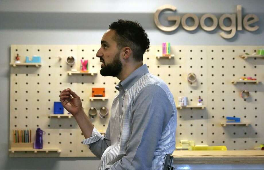 Google's Justin Steele, principal lead for U.S. giving, talks in San Francisco. Right: Shaun Tai (left), founder of Oak land Digital, meets with Jacques Ibula at Google offices. Photo: Michael Macor / Michael Macor / The Chronicle / ONLINE_YES