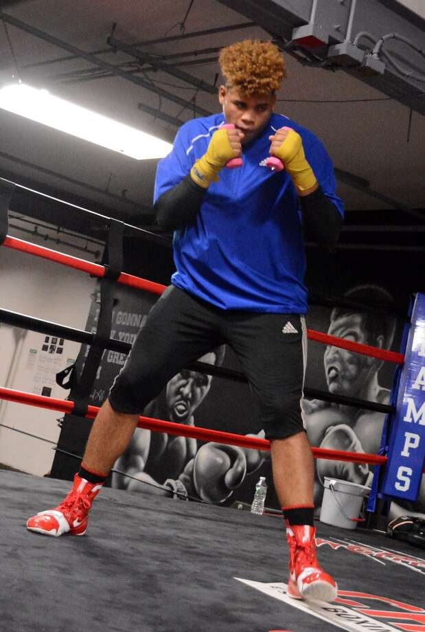 Fernely Feliz Jr., 19, practices boxing at Champs Club and Fitness in Danbury CT on Thursday, Sept. 22, 2016. Photo: Lisa Weir / For Hearst Connecticut Media / The News-Times Freelance