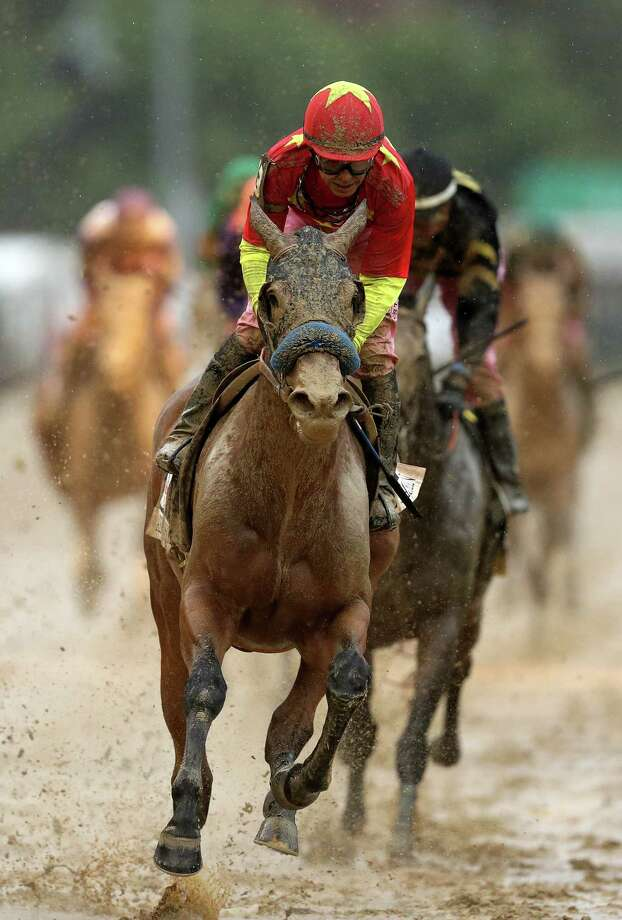 LOUISVILLE, KY - MAY 05:  Jockey Mike Smith celebrates atop Abel Tasman #13 after winning the 143rd running of the Kentucky Oaks at Churchill Downs on May 5, 2017 in Louisville, Kentucky.  (Photo by Patrick Smith/Getty Images) ORG XMIT: 696198835 Photo: Patrick Smith / 2017 Getty Images