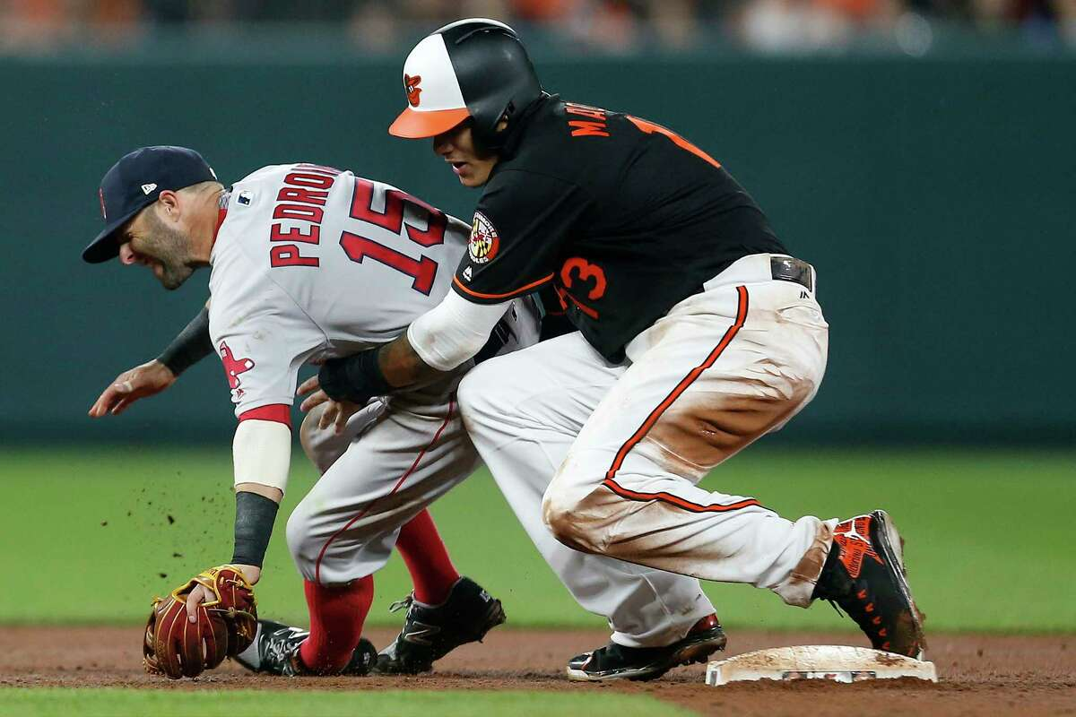 BALTIMORE, MD - APRIL 21: Manny Machado #13 of the Baltimore Orioles collides with Dustin Pedroia #15 of the Boston Red Sox at second base in the eighth inning at Oriole Park at Camden Yards on April 21, 2017 in Baltimore, Maryland. (Photo by Matt Hazlett/Getty Images) ORG XMIT: 700010465