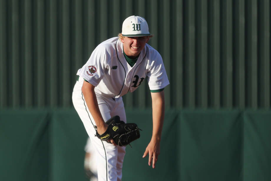 The Woodlands' Steven Beard (16) prepares to throw a pitch during the varsity baseball game against North Mesquite on Friday, May 5, 2017, at Scotland Yard. (Michael Minasi / Houston Chronicle) Photo: Michael Minasi, Staff Photographer / © 2017 Houston Chronicle