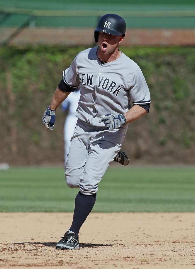 CHICAGO, IL - MAY 05:  Brett Gardner #11 of the New York Yankees yells as he runs the bases after hitting a three run home ini the 9th inning against the Chicago Cubs at Wrigley Field on May 5, 2017 in Chicago, Illinois.  (Photo by Jonathan Daniel/Getty Images) ORG XMIT: 700010662 Photo: Jonathan Daniel / 2017 Getty Images