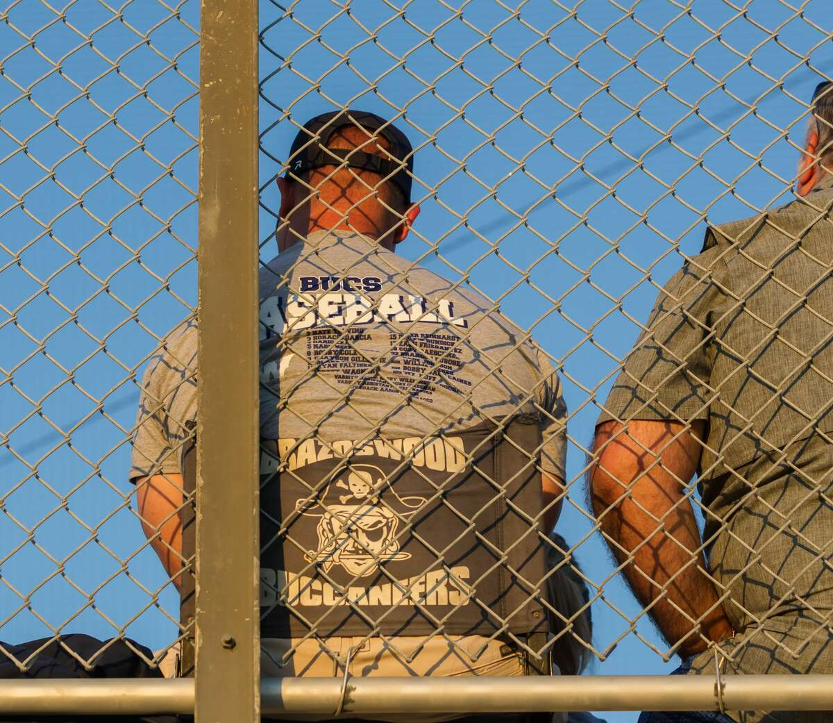May 5, 2017: Brazoswood Buccaneers fan watches the game from the stands during the Region 3 Bi-district playoff game between the Brazoswood Buccaneers and Dickinson Gators in Dickinson, Texas. (Leslie Plaza Johnson/Freelance)