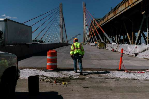 FILE-- Robert Adams, 52, the department of transportation project manager, walking onto the nearly complete Kosciuszko Bridge between Brooklyn and Queens in New York, April 18, 2017. The economy added 211,000 jobs in April, the Labor Department said, after weak hiring figures for March. The jobless rate declined to 4.4 percent. (Jake Naughton/The New York Times)