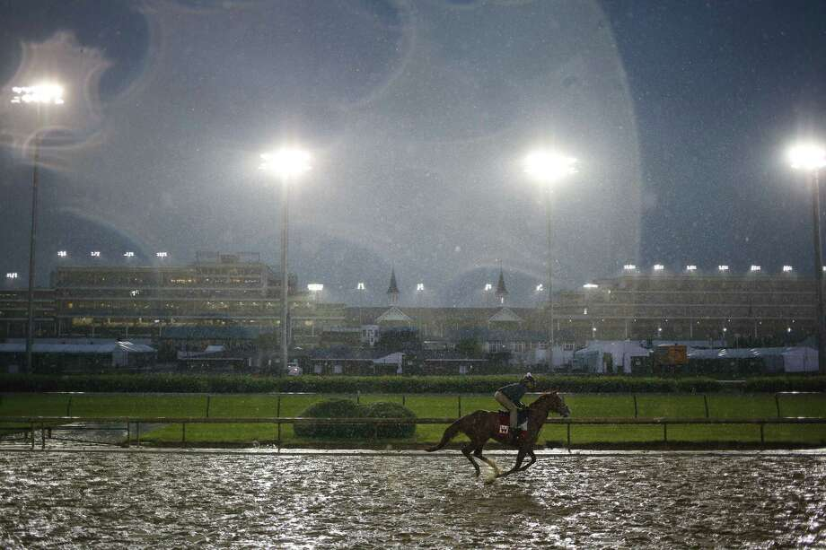A thoroughbred racehorse trains during morning workouts in the rain on the eve of the Kentucky Derby at Churchill Downs in Louisville, Kentucky, U.S., on Friday, May 5, 2017. The 143rd running of the Kentucky Derby will feature a field of twenty horses with the winner receiving a gold trophy plus an estimated $1.24 million payday. Photographer: Luke Sharrett/Bloomberg ORG XMIT: 700045347 Photo: Luke Sharrett / © 2017 Bloomberg Finance LP