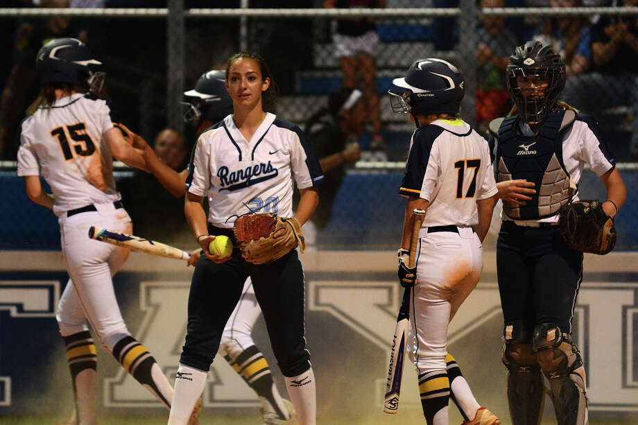 Clements pitcher Miranda Hearn, center, and catcher Keagan Goldwait, right, take in the moment after Cy Ranch junior Cat Crenek (15) scored on a wild pitch during teammate Gabi Lopez's at bat (17) for the the game's only run in the Mustang's win over the Rangers in their Region III-6A Girls Area Round Softball Playoff matchup at Katy Taylor High School on Friday, May 5, 2017. (Photo by Jerry Baker/Freelance Photo: Jerry Baker/For The Chronicle