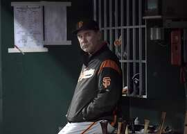San Francisco Giants Manager Bruce Bochy sits in the dugout during the first inning of a baseball game Friday, May 5, 2017, in Cincinnati. (AP Photo/Michael E. Keating)
