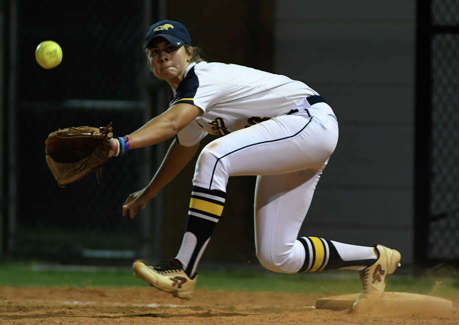 Cy Ranch junior first baseman Bryce West (18) stretches to make a defensive play against Clements in the top of the 6th inning of their Region III-6A Girls Area Round Softball Playoff matchup at Katy Taylor High School on Friday, May 5, 2017. (Photo by Jerry Baker/Freelance Photo: Jerry Baker/For The Chronicle