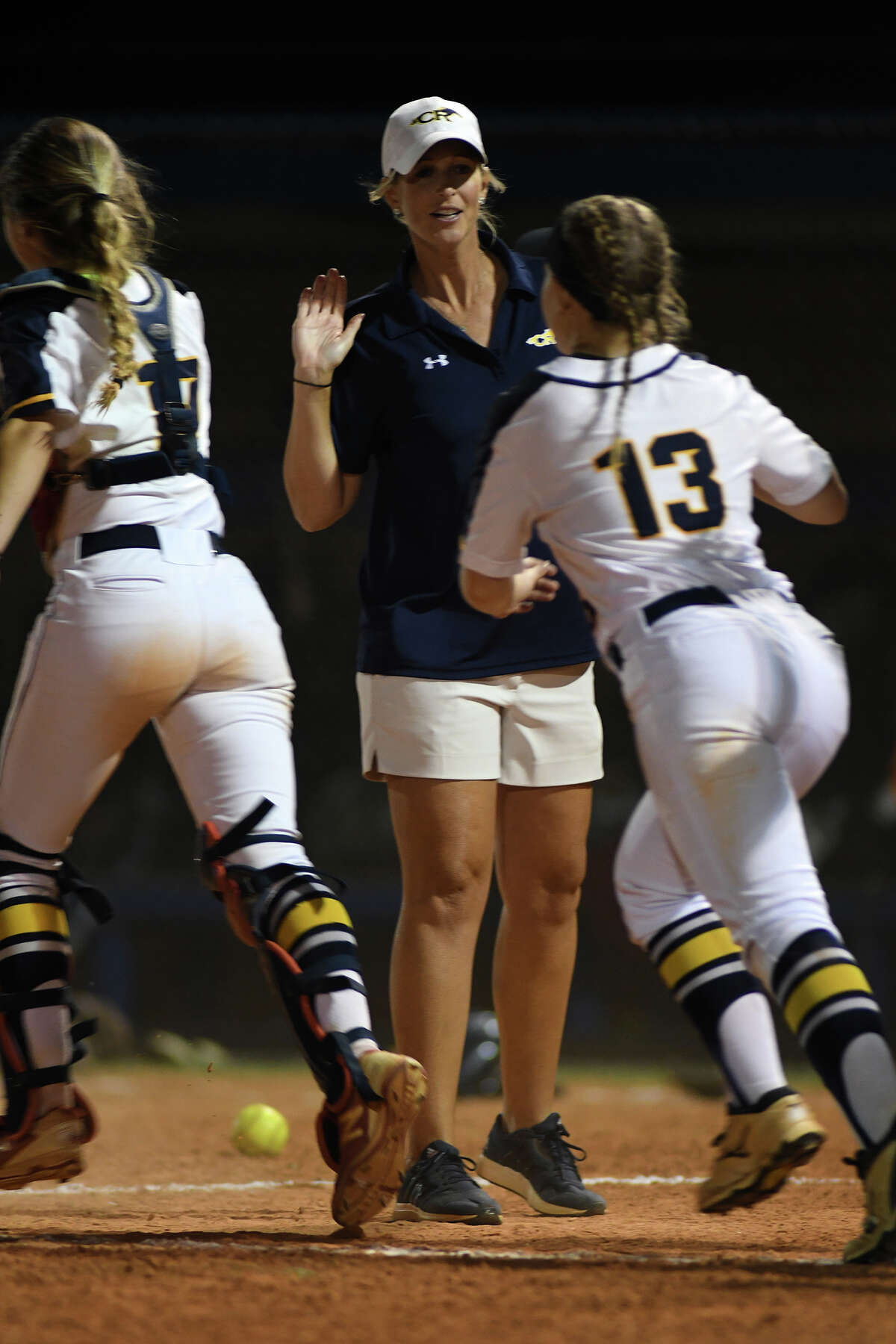 Cy Ranch Head Softball Coach Sarah Mueller congratulates freshman Mackenzie Stuart (13) after the Mustang's 1-0 win over Clements in their Region III-6A Girls Area Round Softball Playoff matchup at Katy Taylor High School on Friday, May 5, 2017. (Photo by Jerry Baker/Freelance