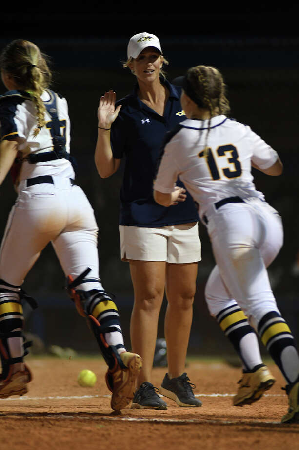Cy Ranch Head Softball Coach Sarah Mueller  congratulates freshman Mackenzie Stuart (13) after the Mustang's 1-0 win over Clements in their Region III-6A Girls Area Round Softball Playoff matchup at Katy Taylor High School on Friday, May 5, 2017. (Photo by Jerry Baker/Freelance Photo: Jerry Baker/For The Chronicle