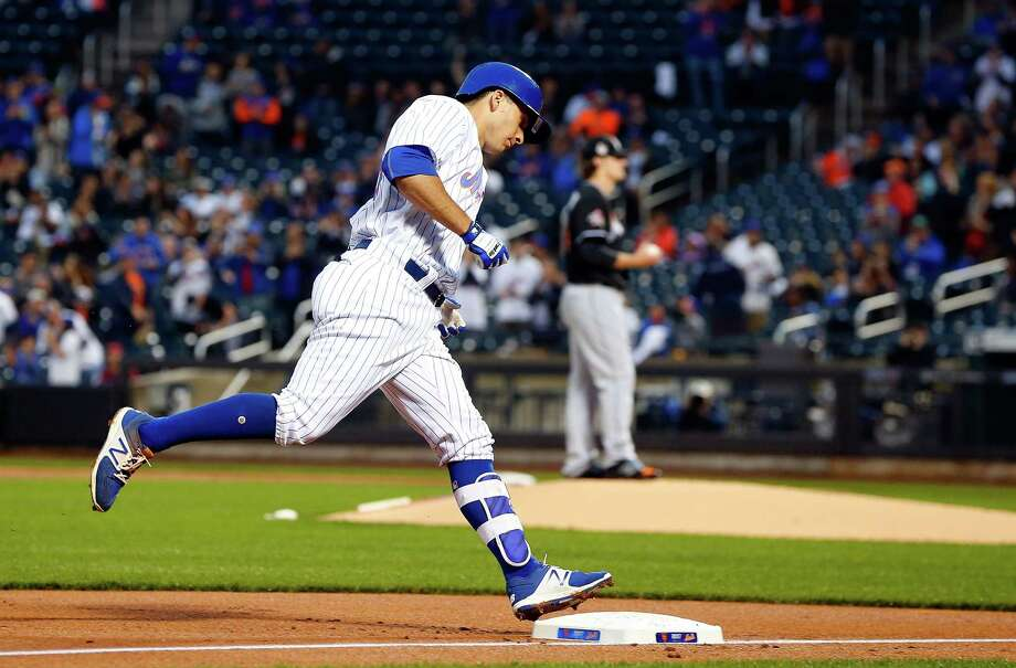 NEW YORK, NY - MAY 05:  T.J. Rivera #54 of the New York Mets runs the bases after his first inning home run against Tom Koehler #34 of the Miami Marlins at Citi Field on May 5, 2017 in the Flushing neighborhood of the Queens borough of New York City.  (Photo by Jim McIsaac/Getty Images) ORG XMIT: 700010672 Photo: Jim McIsaac / 2017 Getty Images