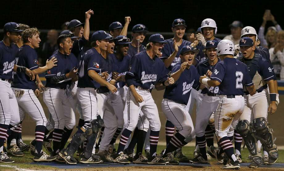 Members of the Smithson Valley Rangers celebrate with teammate Cade Galvan (2) as he crosses home plate after hitting a homer in the 5th inning during their 6-0 win over Clark Friday night. Photo: Edward A. Ornelas / San Antonio Express-News / © 2017 San Antonio Express-News