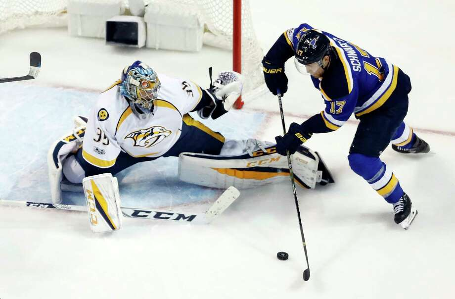 St. Louis Blues left wing Jaden Schwartz (17) closes in on Nashville Predators goalie Pekka Rinne (35), of Finland, during the third period in Game 5 of an NHL hockey second-round playoff series Friday, May 5, 2017, in St. Louis. The Blues beat the Predators 2-1. The Predators lead the series 3-2. (AP Photo/Jeff Roberson) ORG XMIT: MOMH136 Photo: Jeff Roberson / Copyright 2017 The Associated Press. All rights reserved.