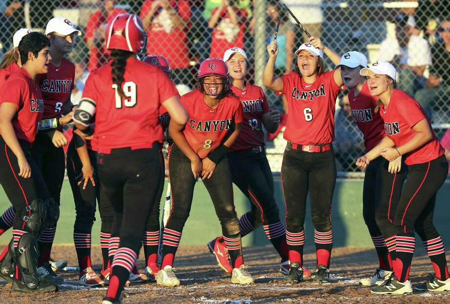 Brooke Vestal runs toward home plate to the applause of New Braunfels Canyon teammates after hitting a home run against MacArthur in a Class 6A second-round softball playoff game on May 5, 2017. Photo: Tom Reel /San Antonio Express-News / 2017 SAN ANTONIO EXPRESS-NEWS