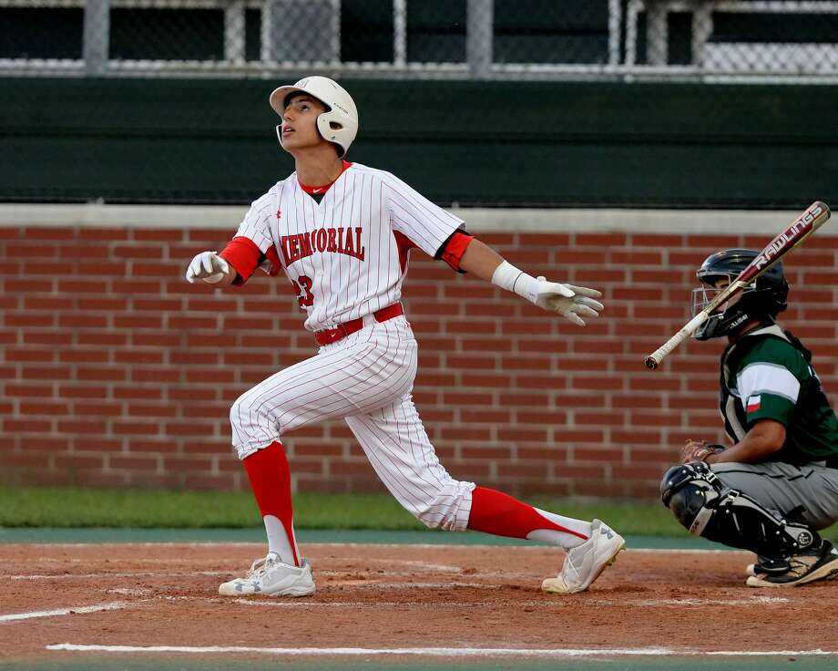 Christian Roa (23) of Memorial hits a sacrifice fly in the fourth inning, driving in the first run for the the Mustangs during a 6A-II bi-district baseball playoff game between the Memorial Mustangs and the Spring Lions on Friday May 5, 2017 at Memorial HS, Houston, TX. Photo: Craig Moseley/Houston Chronicle