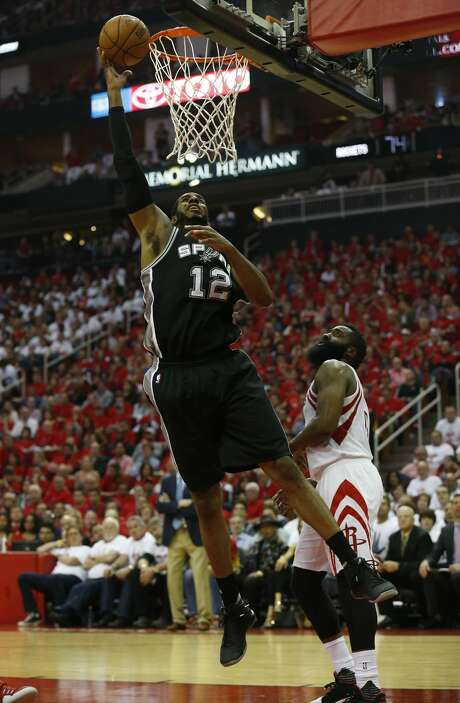 Spurs' LaMarcus Aldridge (12) scores against Houston Rockets' James Harden (13) in Game 3 at the Toyota Center on Friday, May 5, 2017. (Kin Man Hui/San Antonio Express-News) Photo: Kin Man Hui/San Antonio Express-News
