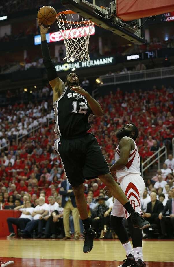 Spurs' LaMarcus Aldridge (12) scores against Houston Rockets' James Harden (13) in Game 3 at the Toyota Center on Friday, May 5, 2017. (Kin Man Hui/San Antonio Express-News) Photo: Kin Man Hui/San Antonio Express-News