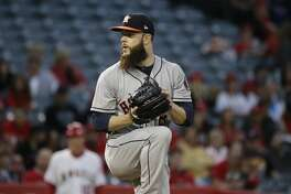 Houston Astros starting pitcher Dallas Keuchel winds up to throw against the Los Angeles Angels during the first inning of a baseball game, Friday, May 5, 2017, in Anaheim, Calif. (AP Photo/Jae C. Hong)
