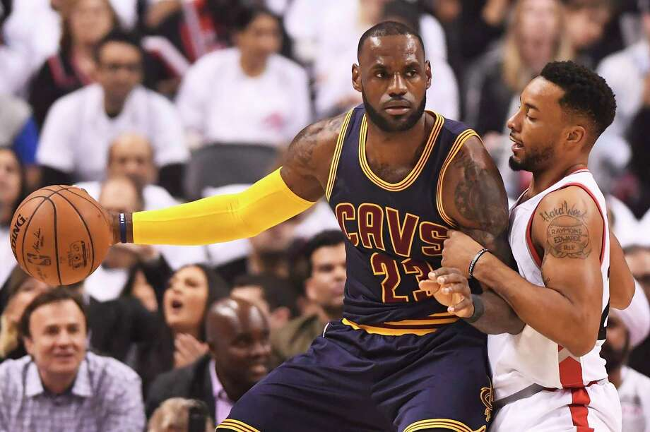 Cleveland Cavaliers forward LeBron James (23) protects the ball from Toronto Raptors guard Norman Powell (24) during the first half of Game 3 of an NBA basketball second-round playoff series in Toronto on Friday, May 5, 2017. (Frank Gunn/The Canadian Press via AP) ORG XMIT: FNG502 Photo: Frank Gunn / THE CANADIAN PRESS