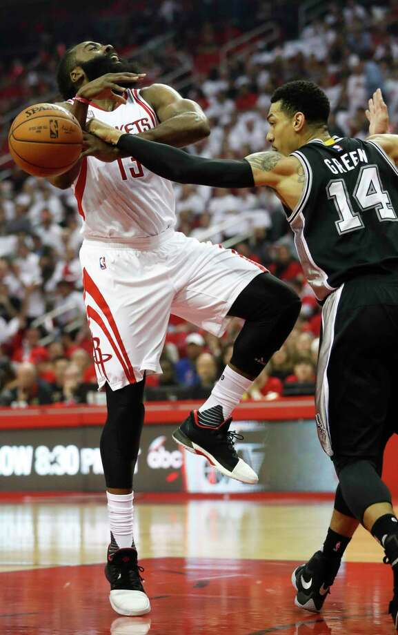 Houston Rockets guard James Harden (13) is fouled by San Antonio Spurs guard Danny Green (14) during the first quarter of the NBA Western Conference semifinals playoff Game 3 at Toyota Center Friday, May 5, 2017, in Houston. ( Karen Warren / Houston Chronicle ) Photo: Karen Warren, Staff / © 2017  Houston Chronicle