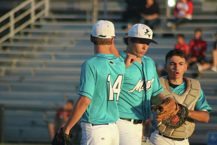 Mavs pitcher Bubba Baxa is greeted by Mason Mahoney (14) and catcher Johnatan Rodriguez as he comes off the field, escaping another mini jam Friday night. Photo: Robert Avery