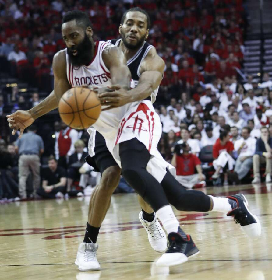 San Antonio Spurs forward Kawhi Leonard (2) tries to strip the ball from Houston Rockets guard James Harden (13) during the second half of the NBA Western Conference semifinals playoff Game 3 at Toyota Center Friday, May 5, 2017, in Houston. ( Karen Warren / Houston Chronicle ) Photo: Karen Warren/Houston Chronicle