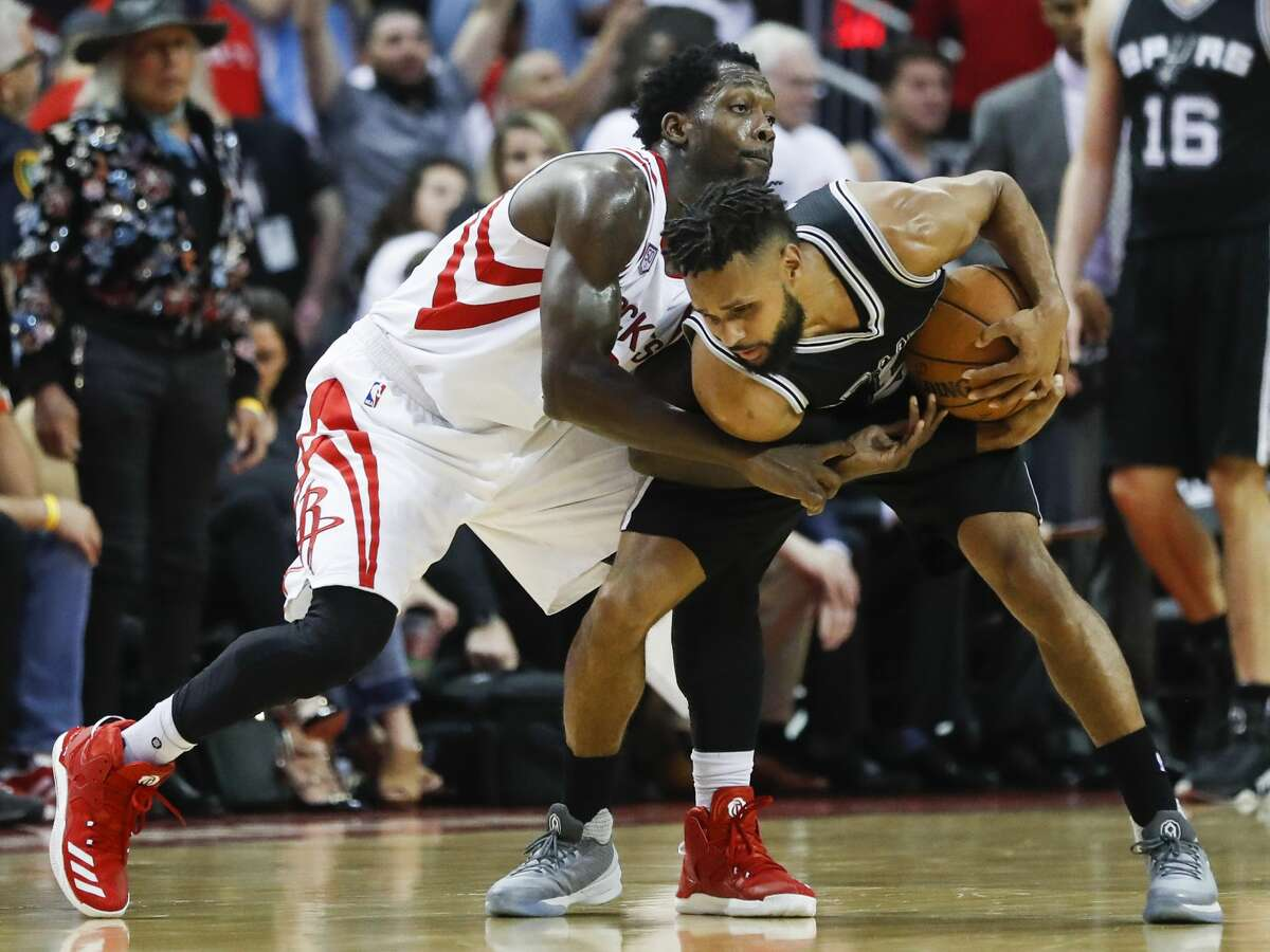 Houston Rockets guard Patrick Beverley (2) battles with San Antonio Spurs guard Patty Mills (8) during the second half of the NBA Western Conference semifinals playoff Game 3 at Toyota Center Friday, May 5, 2017, in Houston. ( Karen Warren / Houston Chronicle )