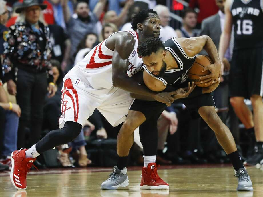 Houston Rockets guard Patrick Beverley (2) battles with San Antonio Spurs guard Patty Mills (8) during the second half of the NBA Western Conference semifinals playoff Game 3 at Toyota Center Friday, May 5, 2017, in Houston. ( Karen Warren / Houston Chronicle ) Photo: Karen Warren/Houston Chronicle
