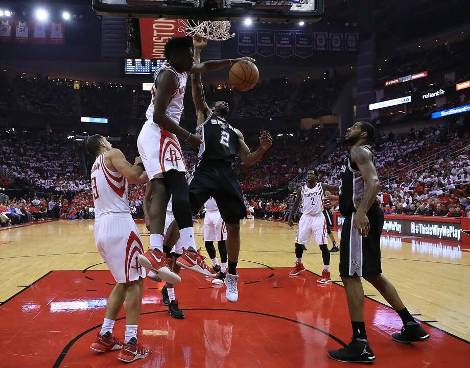 HOUSTON, TX - MAY 05:  Kawhi Leonard #2 of the San Antonio Spurs dunks against Clint Capela #15 of the Houston Rockets during Game Three of the NBA Western Conference Semi-Finals at Toyota Center on May 5, 2017 in Houston, Texas.  NOTE TO USER: User expressly acknowledges and agrees that, by downloading and or using this photograph, User is consenting to the terms and conditions of the Getty Images License Agreement.  (Photo by Ronald Martinez/Getty Images) Photo: Ronald Martinez/Getty Images