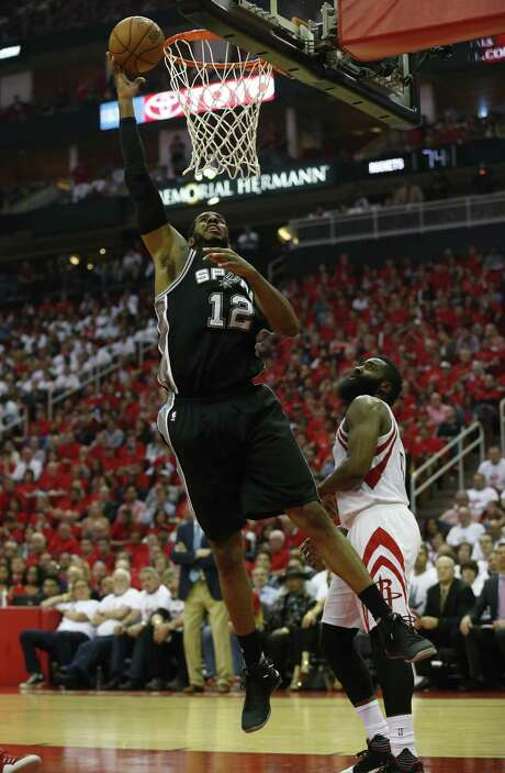 Spurs' LaMarcus Aldridge (12) scores against Houston Rockets' James Harden (13) in Game 3 at the Toyota Center on Friday, May 5, 2017. (Kin Man Hui/San Antonio Express-News) Photo: Kin Man Hui, Staff / San Antonio Express-News / ©2017 San Antonio Express-News