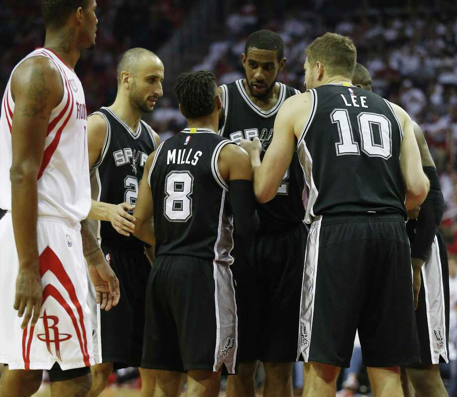 Spurs' LaMarcus Aldridge (12) gathers with the team on the floor against the Houston Rockets in Game 3 at the Toyota Center on Friday, May 5, 2017. (Kin Man Hui/San Antonio Express-News) Photo: Kin Man Hui, Staff / San Antonio Express-News / ©2017 San Antonio Express-News