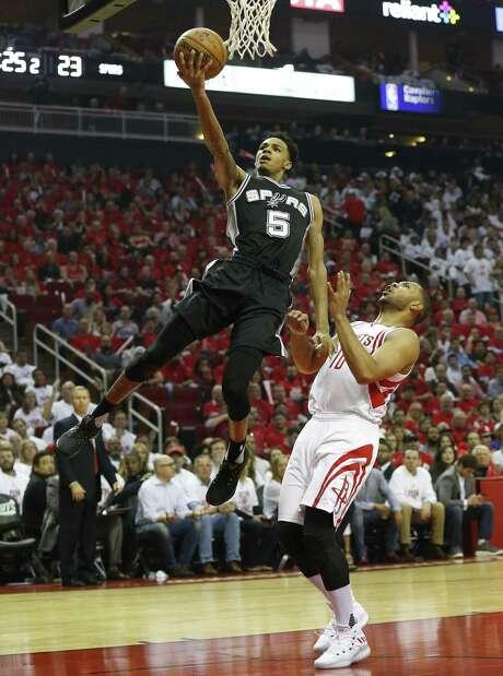 Spurs' Dejounte Murray (05) scores against Houston Rockets' Eric Gordon (10) at the Toyota Center on Friday, May 5, 2017. (Kin Man Hui/San Antonio Express-News) Photo: Kin Man Hui, Staff / San Antonio Express-News / ©2017 San Antonio Express-News