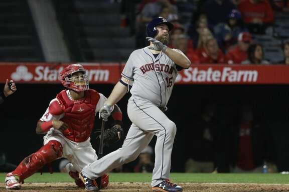Houston Astros' Brian McCann watches after hitting a three-run home run against the Los Angeles Angels during the seventh inning of a baseball game, Friday, May 5, 2017, in Anaheim, Calif. (AP Photo/Jae C. Hong)