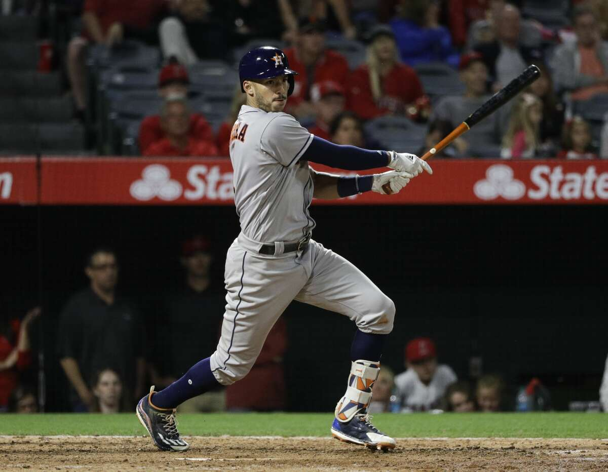 Houston Astros' Carlos Correa hits a RBI single against the Los Angeles Angels during the 10th inning of a baseball game, Friday, May 5, 2017, in Anaheim, Calif. The Astros won 7-6 in the 10 innings. (AP Photo/Jae C. Hong)