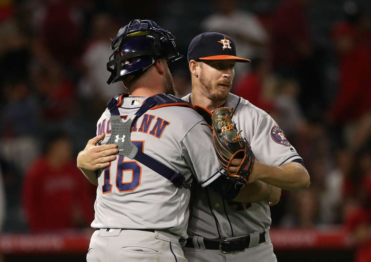 ANAHEIM, CA - MAY 05: Catcher Brian McCann #16 and pitcher Chris Devenski #47 of the Houston Astros celebrate after their 7-6 10-inning win against Los Angeles Angels of Anaheim in their MLB game at Angel Stadium of Anaheim on May 5, 2017 in Anaheim, California. (Photo by Victor Decolongon/Getty Images)