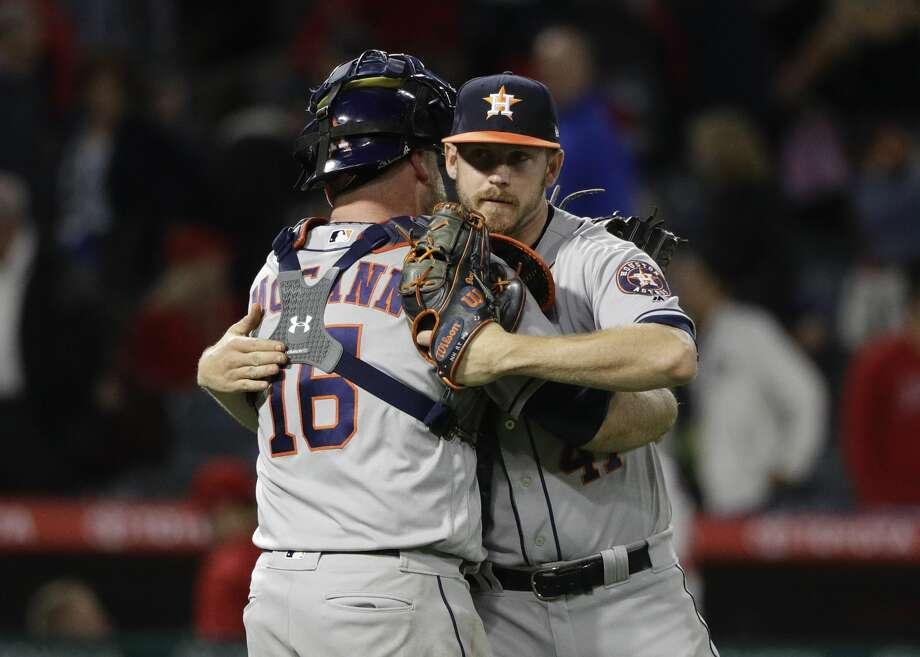Houston Astros relief pitcher Brad Peacock, right, hugs catcher Brian McCann after their team defeated the Los Angeles Angels 7-6 in the 10 innings in a baseball game, Friday, May 5, 2017, in Anaheim, Calif. (AP Photo/Jae C. Hong) Photo: Jae C. Hong/Associated Press