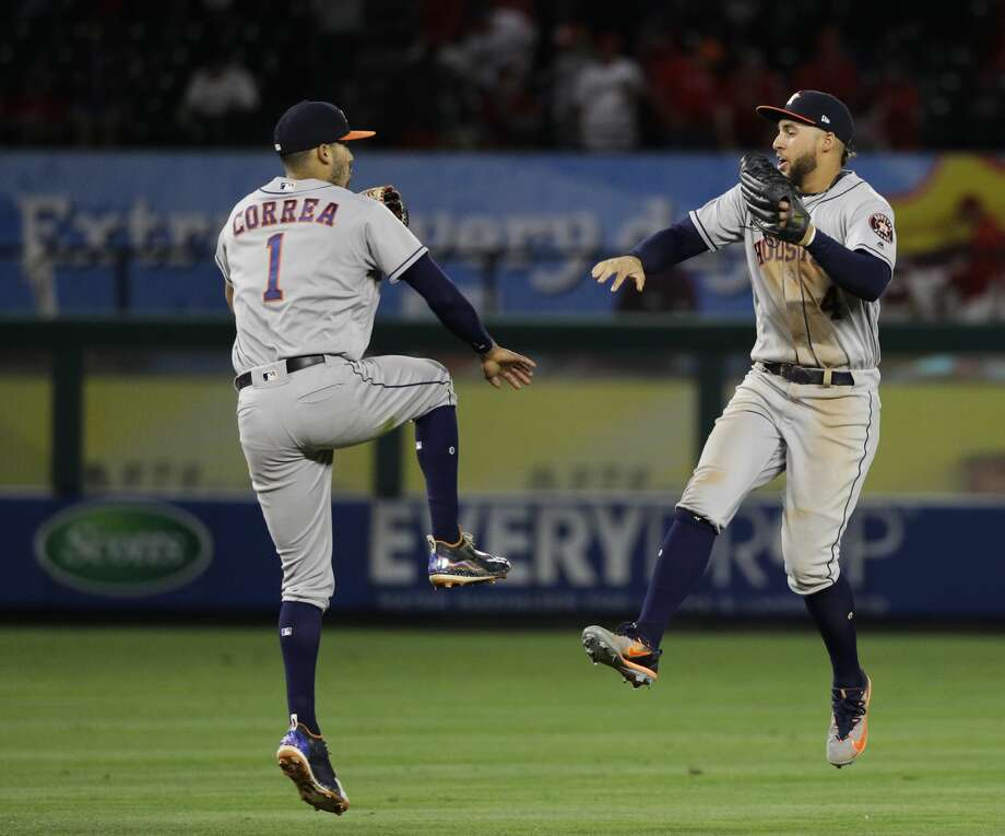 Houston Astros' Carlos Correa, left, and George Springer celebrate after defeating the Los Angeles Angels in a baseball game, Friday, May 5, 2017, in Anaheim, Calif. The Astros won 7-6 in the 10 innings. (AP Photo/Jae C. Hong) Photo: Jae C. Hong/Associated Press