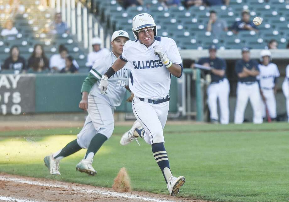 Albert Gonzalez hit his second home run of the season Thursday in Alexander's 10-2 loss to Reagan. Gonzalez is likely to take the mound in Game 2 as the Bulldogs look to keep their season alive. Photo: Danny Zaragoza /Laredo Morning Times File