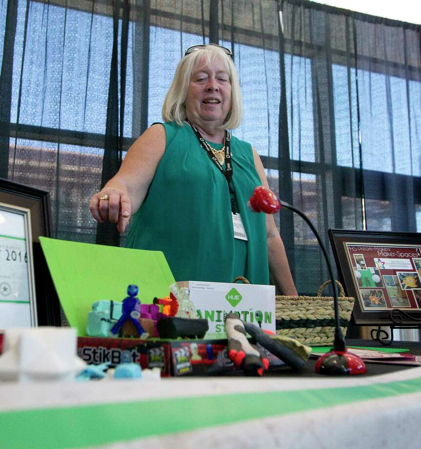 Jeannie Reed shows various items students made from 3-D printers and other tools as part of her and Lisa Herr's $50,000 grant during New Caney ISD Education Foundation's Breeze into Summer event at Texan Drive Stadium, Friday, May 5, 2017, in New Caney. Photo: Jason Fochtman, Staff Photographer / © 2017 Houston Chronicle