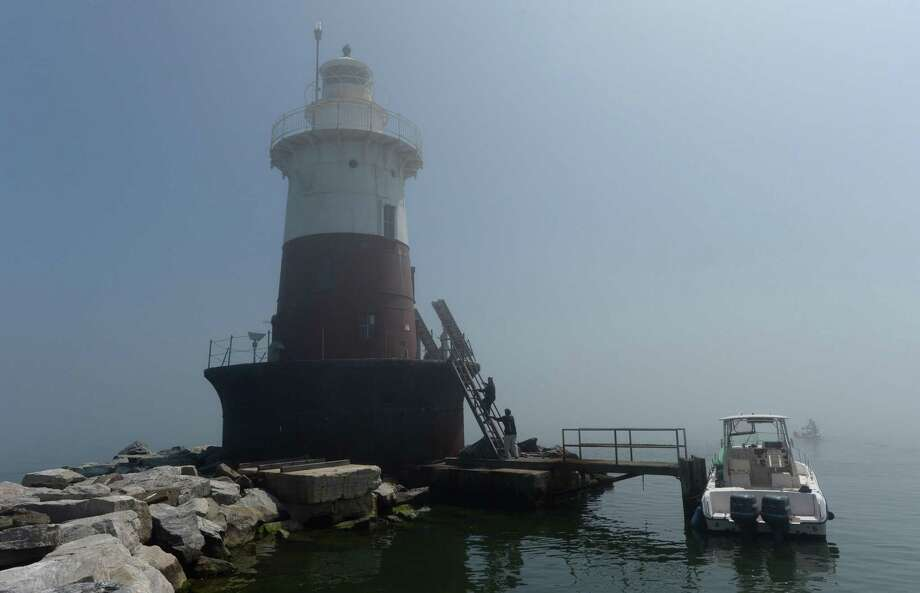 Rowayton resident, Founder and Executive Director of the Greens Ledge Light Preservation Society, Brendan McGee, and Society President, Tim Pettee, tour the Greens Ledge Lighthouse Friday, April 26, 2017, one mile off the coast of Rowayton in Norwalk, Conn. The U.S. General Services Administration New England revealed last month that Rowayton resident Tim Pettee and the Greens Ledge Light Preservation Society were awarded the lighthouse which was built at the turn of the twentieth century following the GSA auction in July last year. Photo: Erik Trautmann / Hearst Connecticut Media / Norwalk Hour
